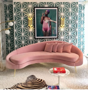 green color wall enhancement and pink color funniture make a house very cosy